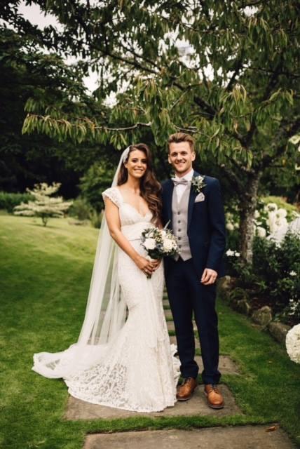 bride wearing an anna campbell dress
